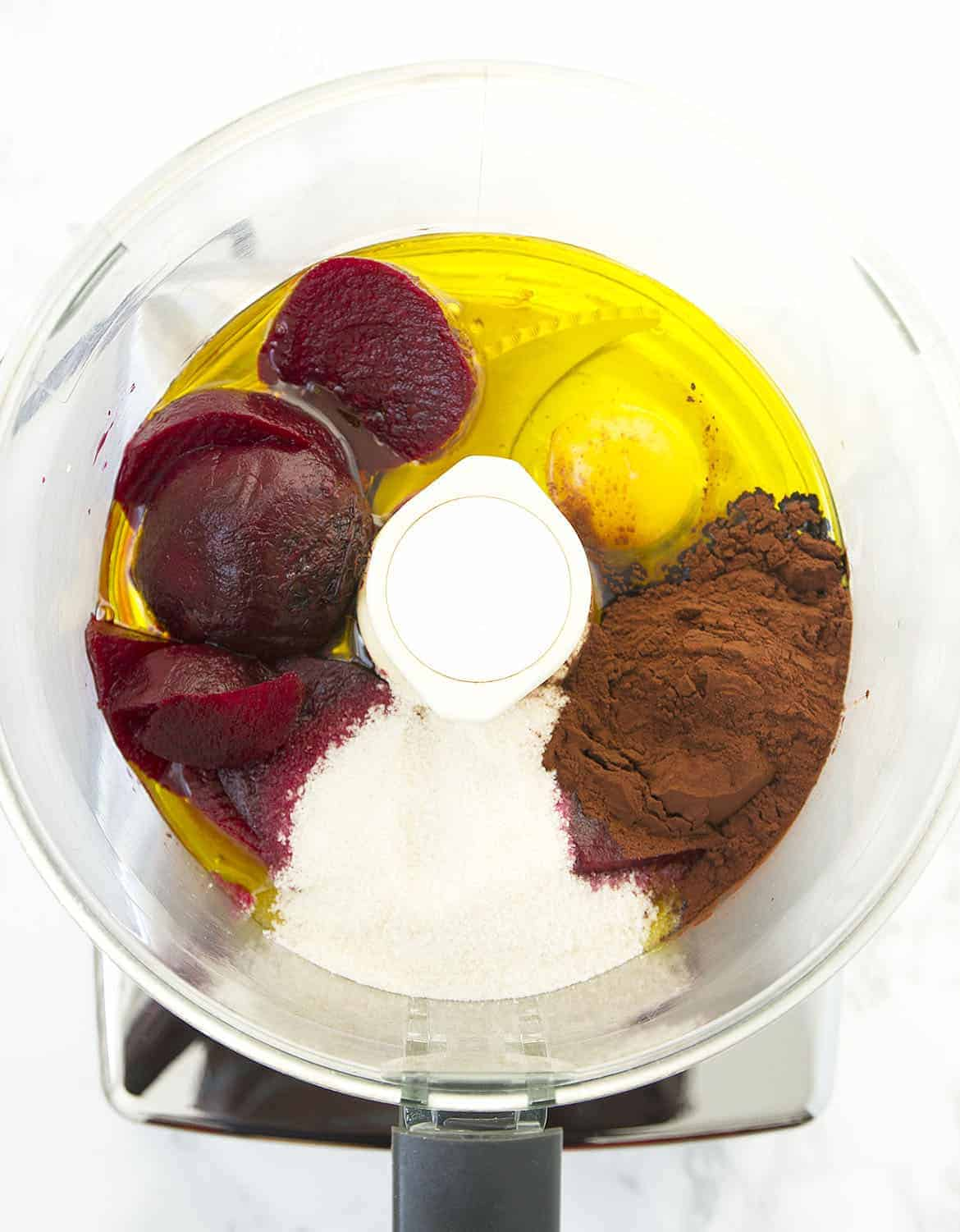 Beetroots, egg, sugar, oil and cocoa powder into a food processor.