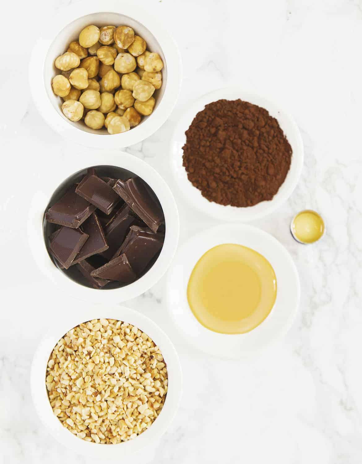 The ingredients for these homemade Ferrero Rocher truffles are arranged over a white background.