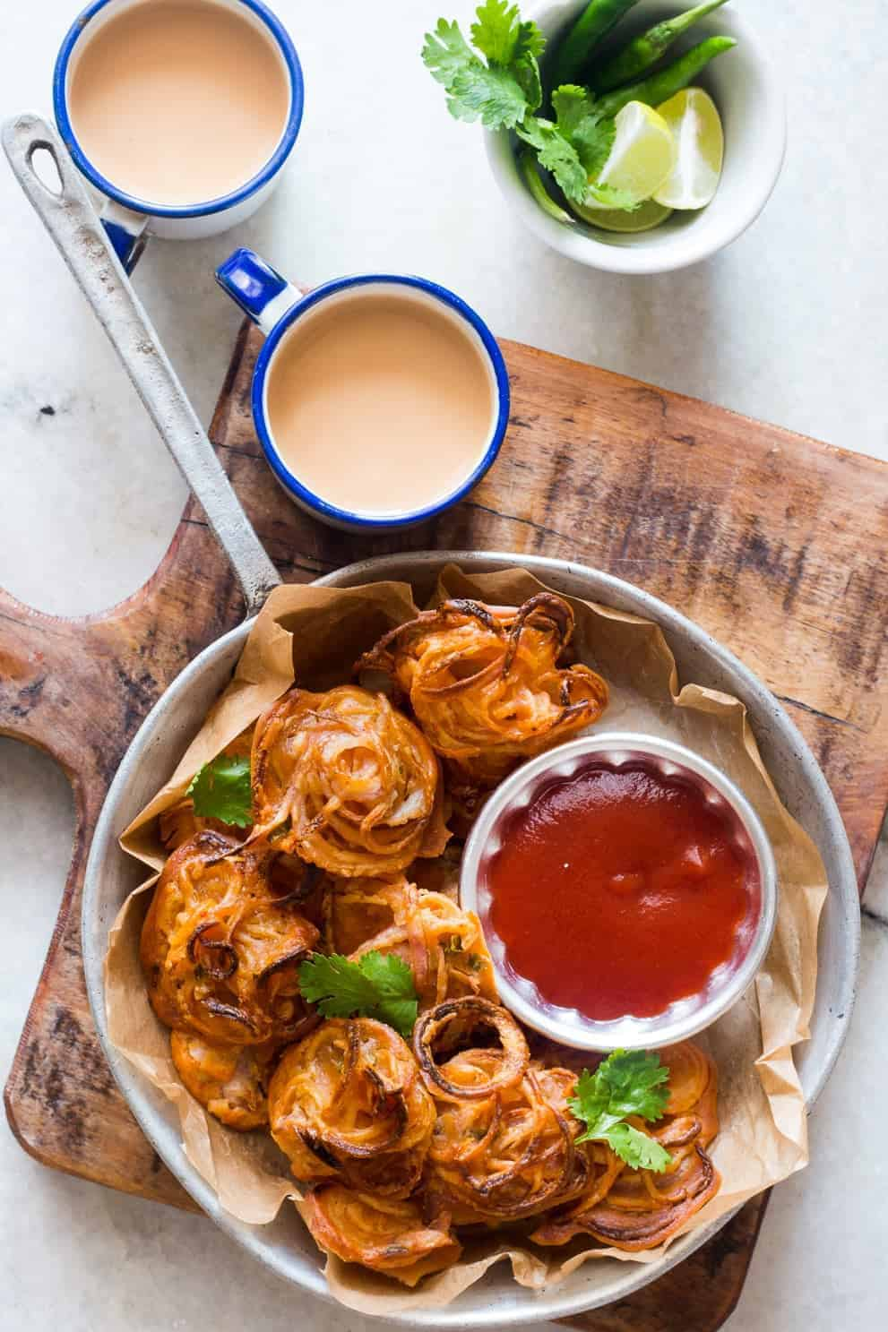 CRISPY BAKED ONIONS FRITTERS (PAKODAS) by My Food Story: These delicious and easy veganappetizers are what you'll need for your Christmas feast. The most incredible, healthy and inexpensive party food perfect to please a crowd!