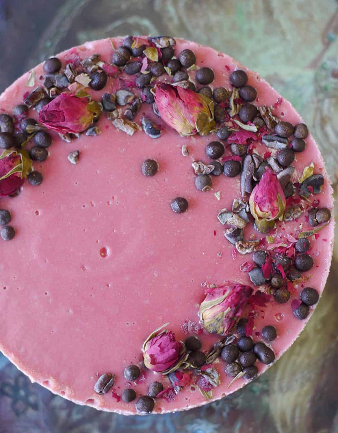Vegan CHOCOLATE BEET CHEESECAKE decorated with dried roses and chocolate chips - Unconventional Baker