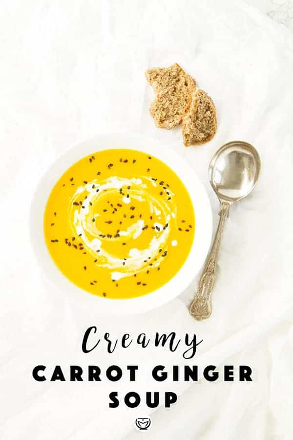This bright, vibrantly spiced creamy carrot and ginger soup is the perfect winter warmer. Not only is this plant-based and vegan soup satisfying and nourishing, but it is easy to digest and uses amazing anti-inflammatory and detox ingredients. A bowl of golden goodness, budget-friendly, super healthy and ready in 30 minutes. #veganrecipes #detoxsoup #lowcarbrecipes