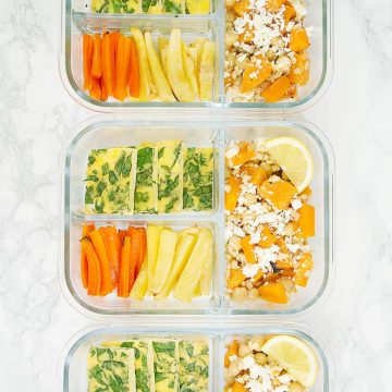 Roasted winter vegetables with feta and frittata in meal prep containers.