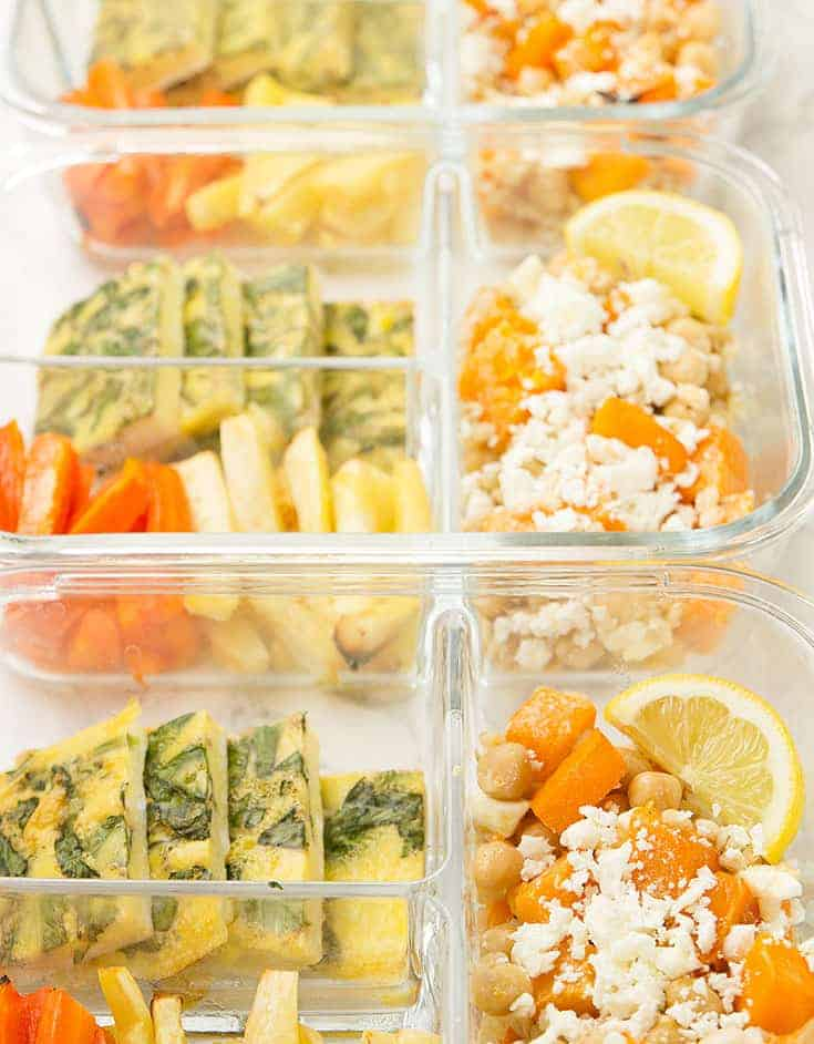Roasted winter vegetable salad in glass containers.
