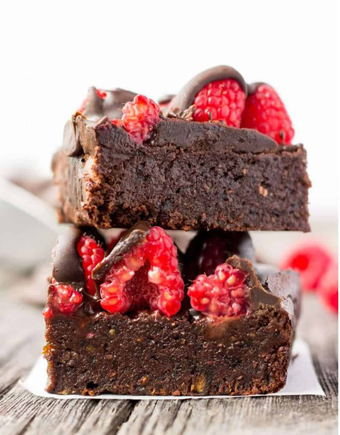 Two pieces of raspberry and dark chocolate protein brownies - One Clever Chef