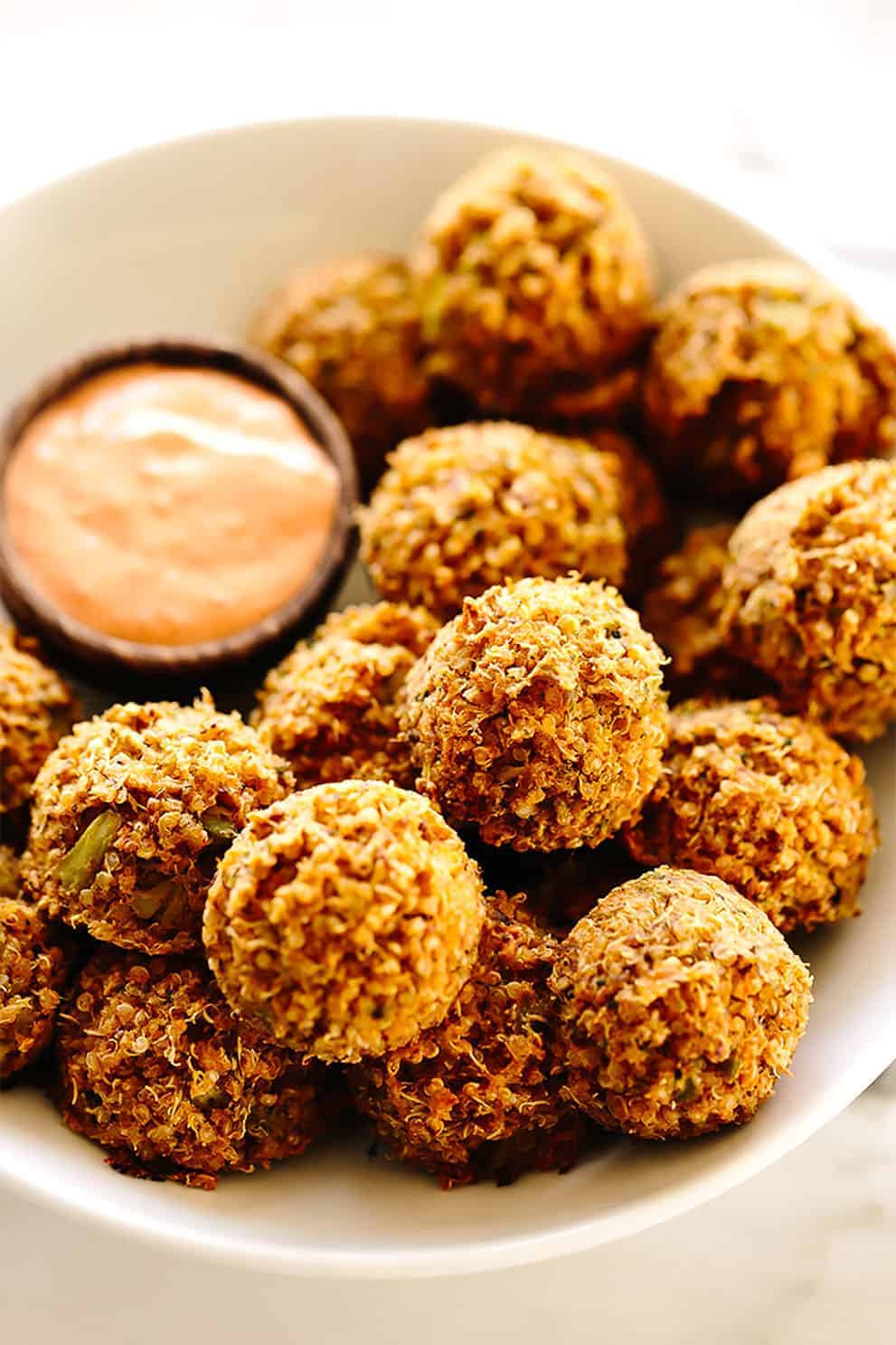 VEGAN CHEESY BROCCOLI QUINOA BITES WITH SRIRACHA AIOLI by Blissful Basil:these delicious, easy and vegan appetizers are perfect to please a crowd!