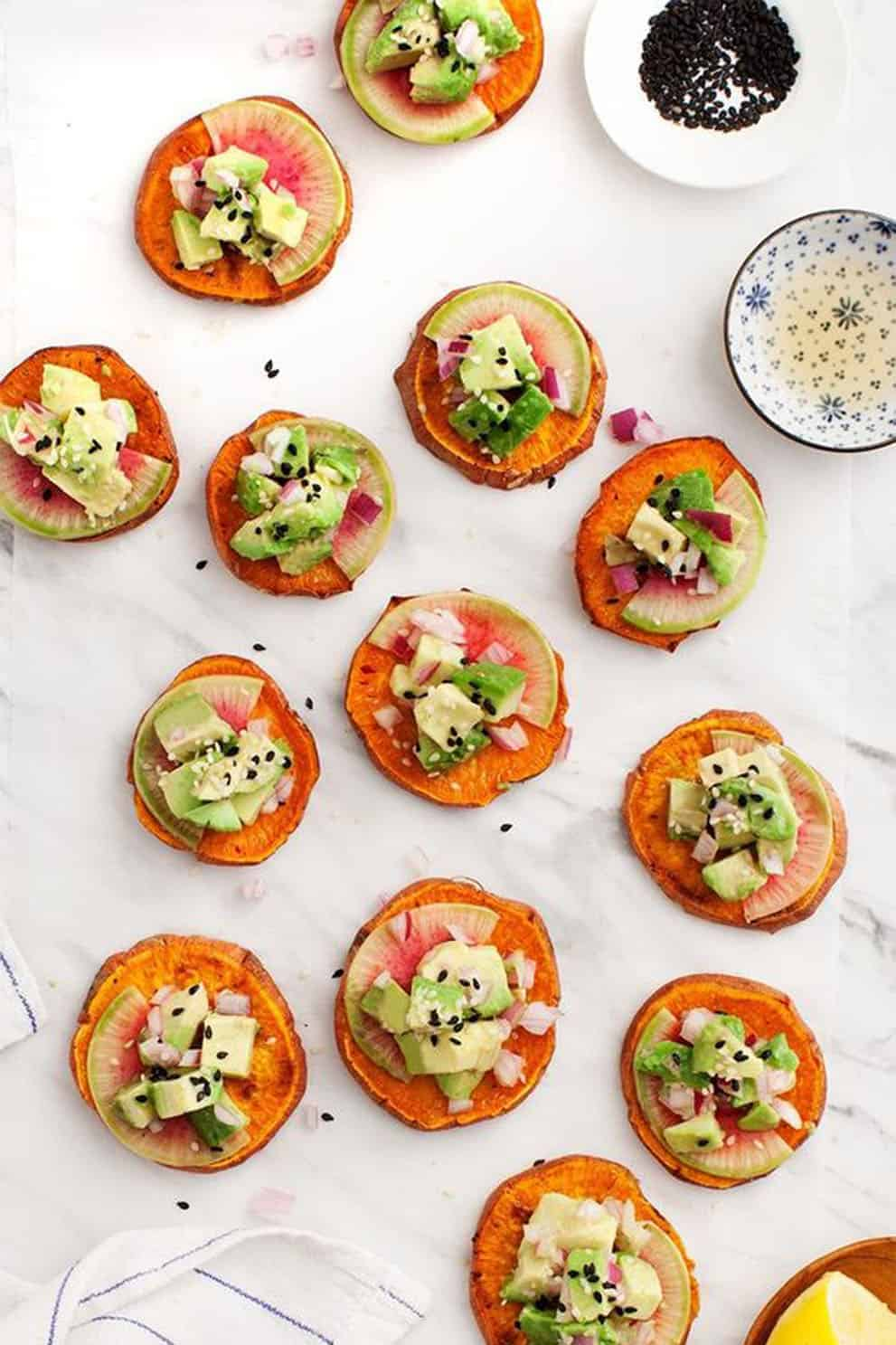 Sweet potato avocado tartare canapés in a white background - Love and Lemons