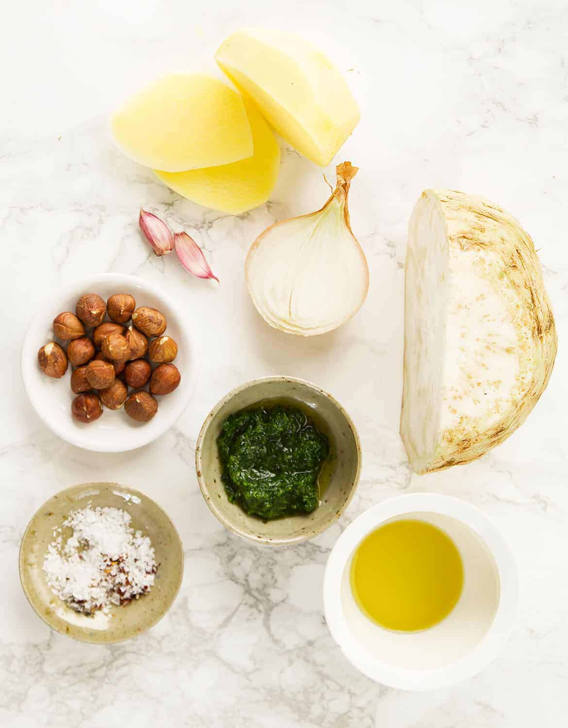 The ingredients for the celeriac soup are arranged over a white background.