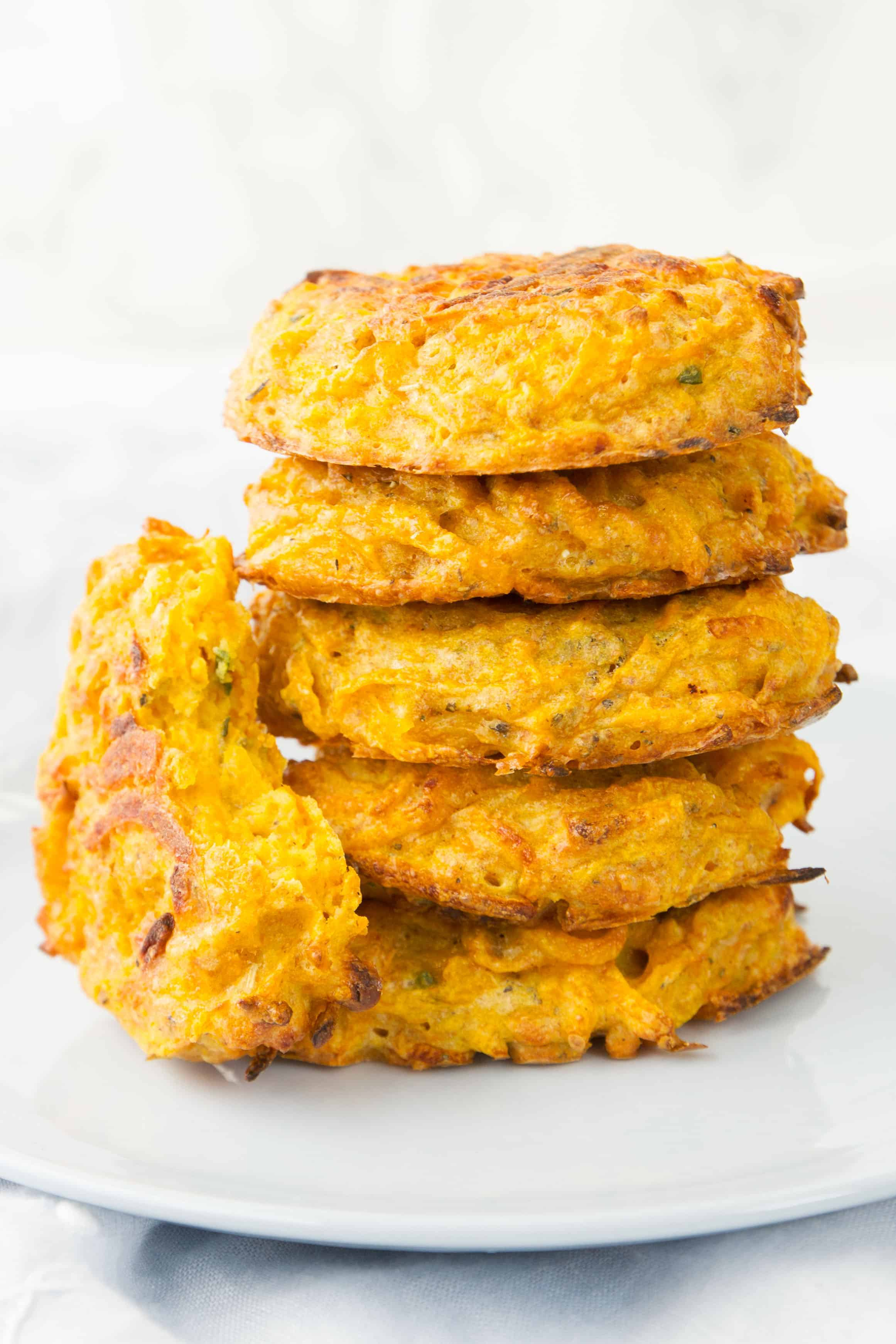 These butternut squash fritters are a tiny bit sweet, as sweet squash is, but the sage and parmesan mellow that out so the fritters are more savory than you'd think they'd be. They are just perfect, light, guilt-free and delicious! #cheapmeals #easydinnerrecipes #healthyrecipes #squash #lightmeals #easyrecipes