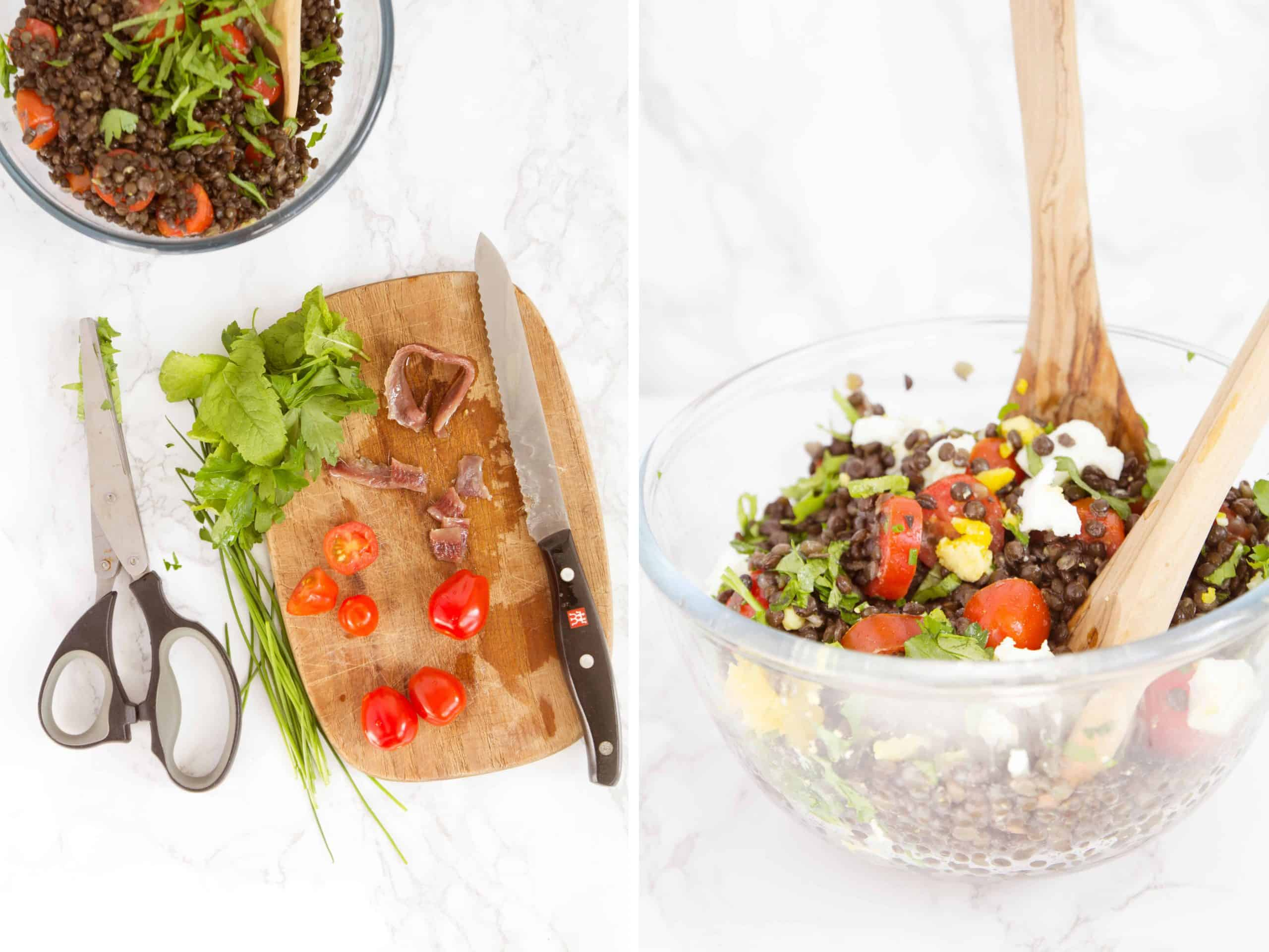 A chopping board with herbs, anchovies and tomatoes and a bowl full of lentil salad with two wooden spoons.