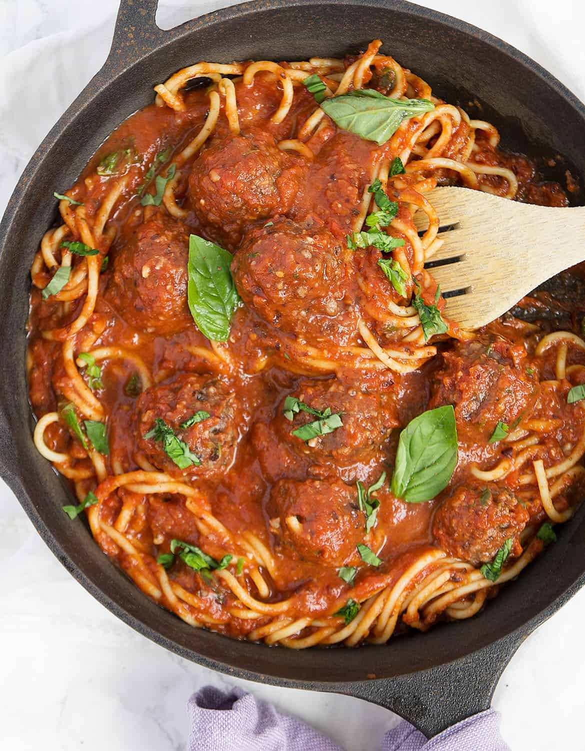 Succulent and tender meatless meatballs in a cast iron skillet.