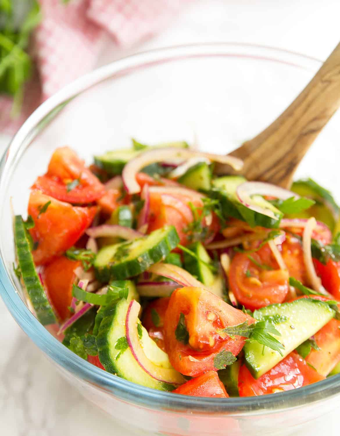 This light and refreshing Italian tomato and cucumber salad is a must. It's packed with flavor and vitamins, it comes together in 5 minutes and makes everyone happy.