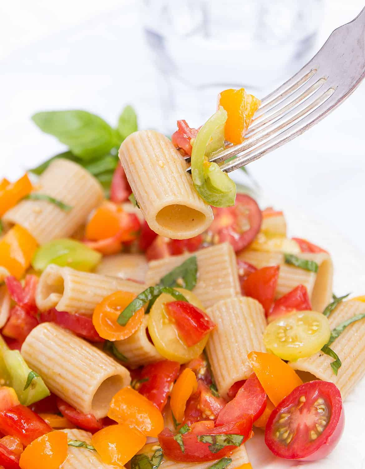 This raw cherry tomato pasta is summer on a plate! Ripe and juicy tomatoes, fresh garlic, basil and extra virgin olive oil make the best pasta sauce ever!