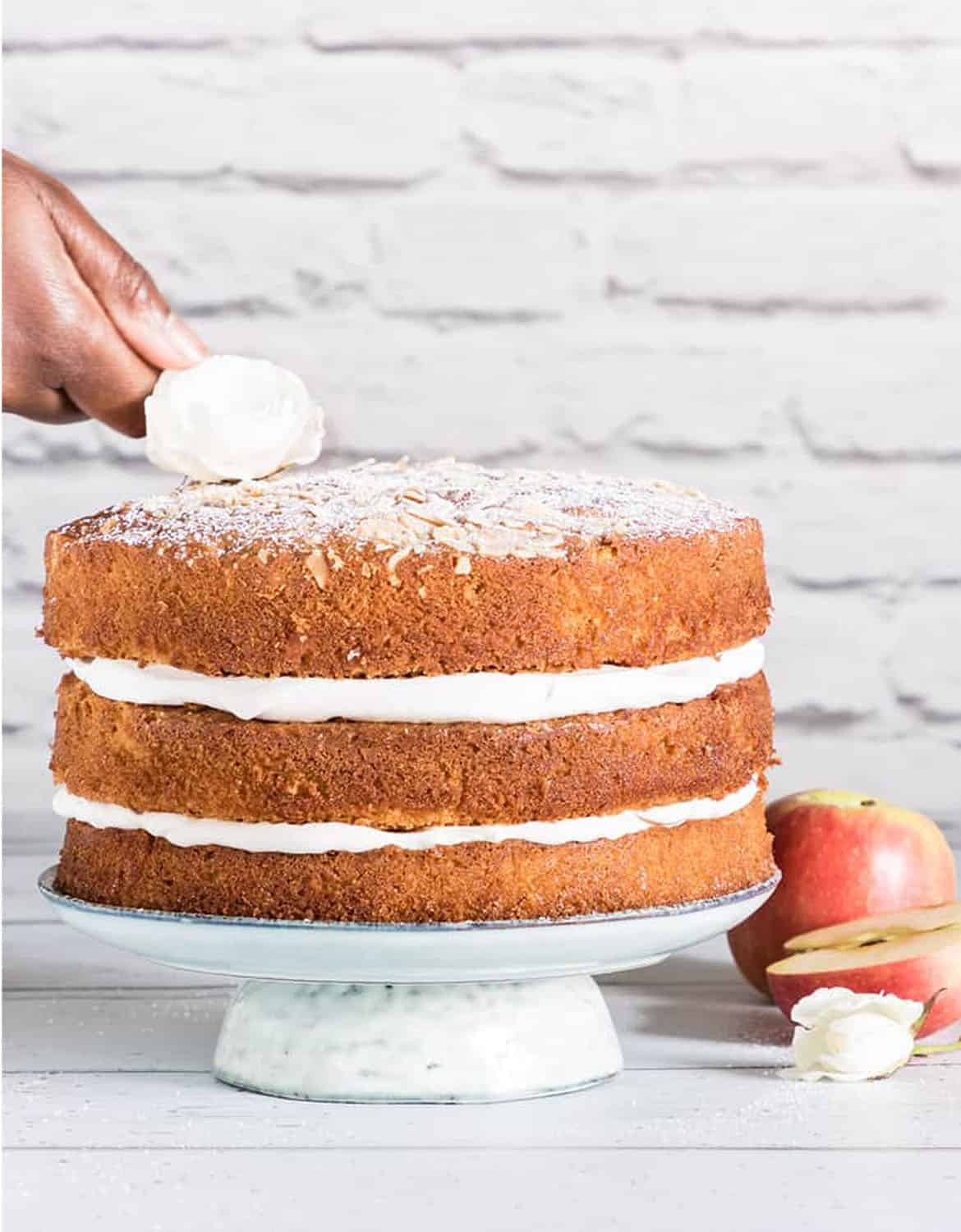 Three layer apple cake over a white wall background - Recipes from a pantry