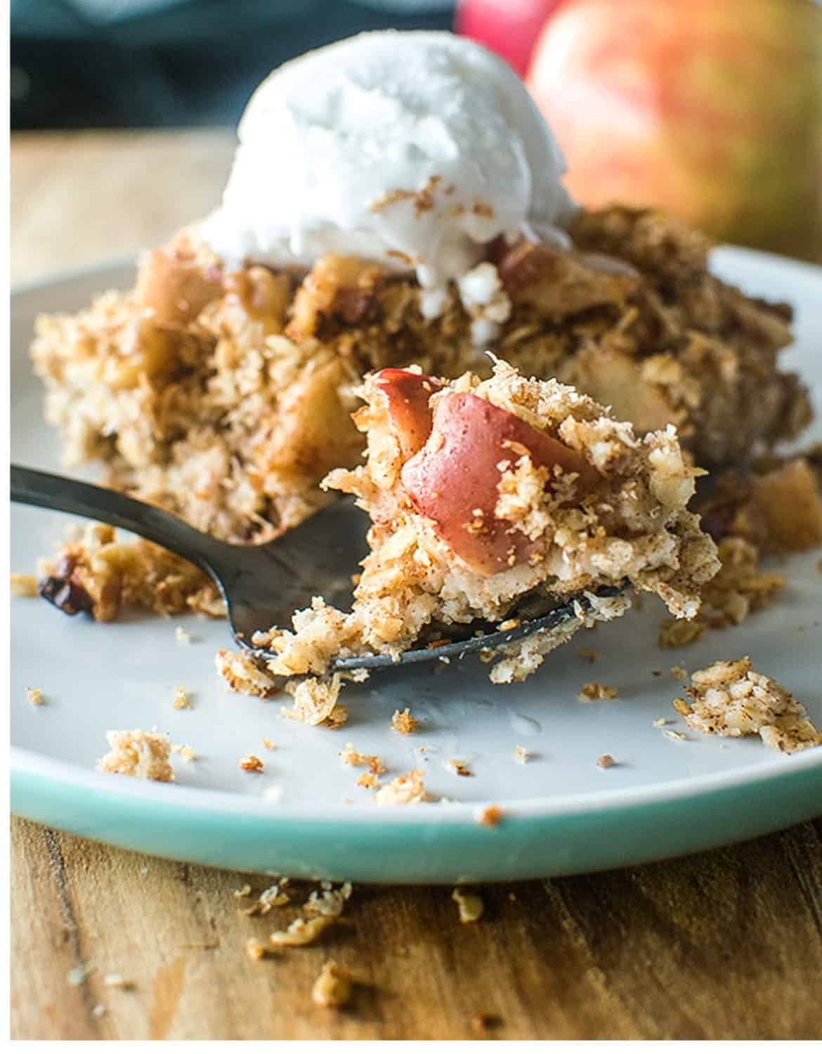 Apple crumble baked oats with ice cream on a turquoise plate - Tilly Eats