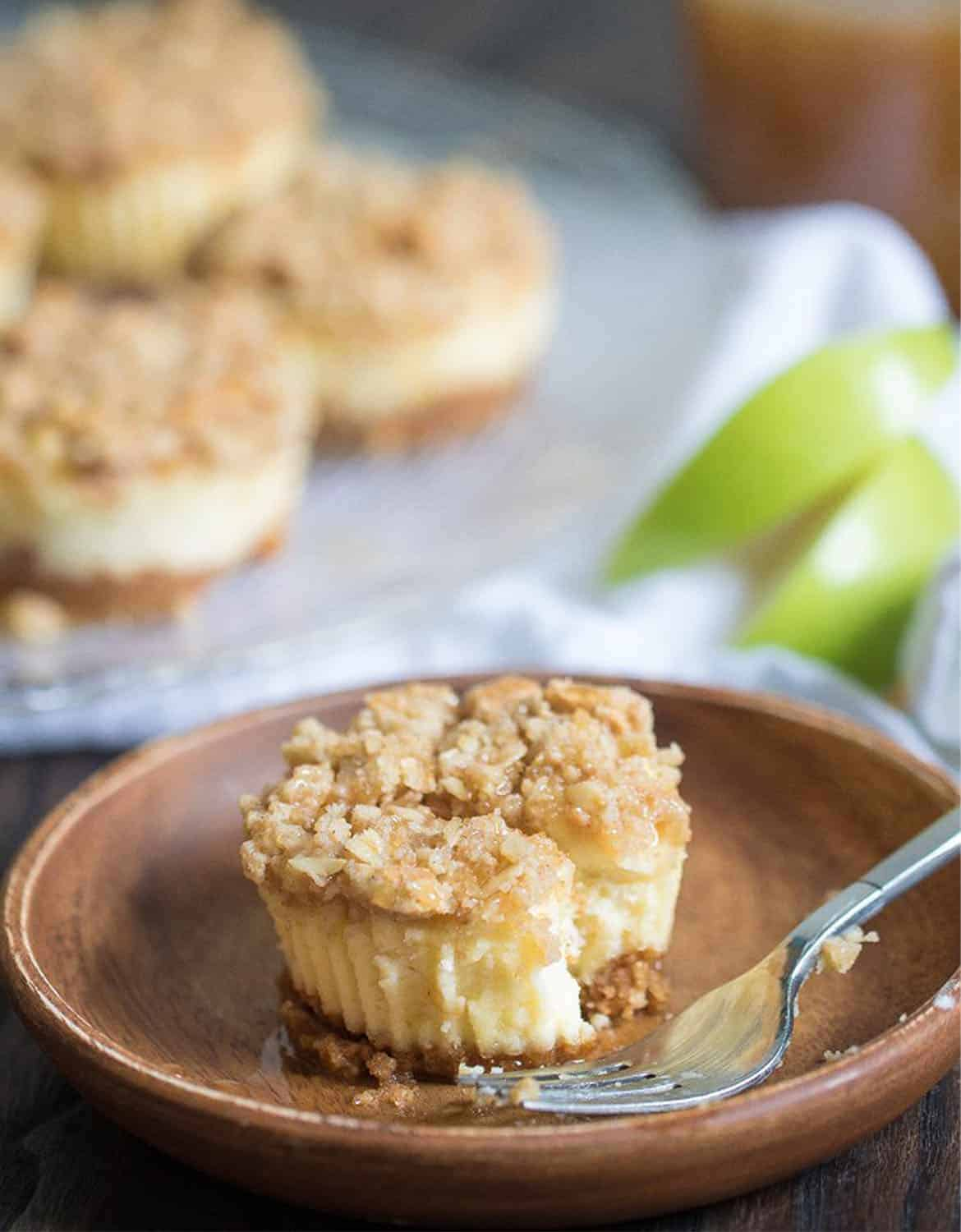 A caramel apple streusel cheesecake bites on a brown plate - Orchidsandsweetea
