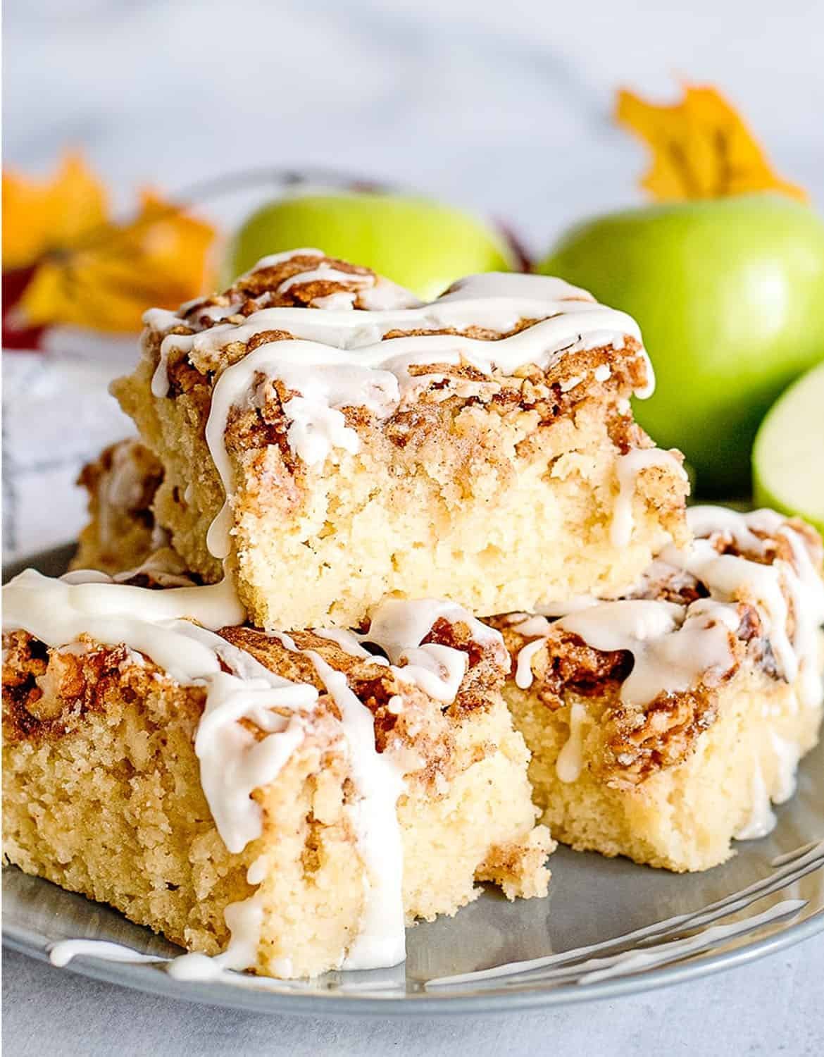 Apple fritter breakfast cake with green apples in the background - Courtney's Sweets
