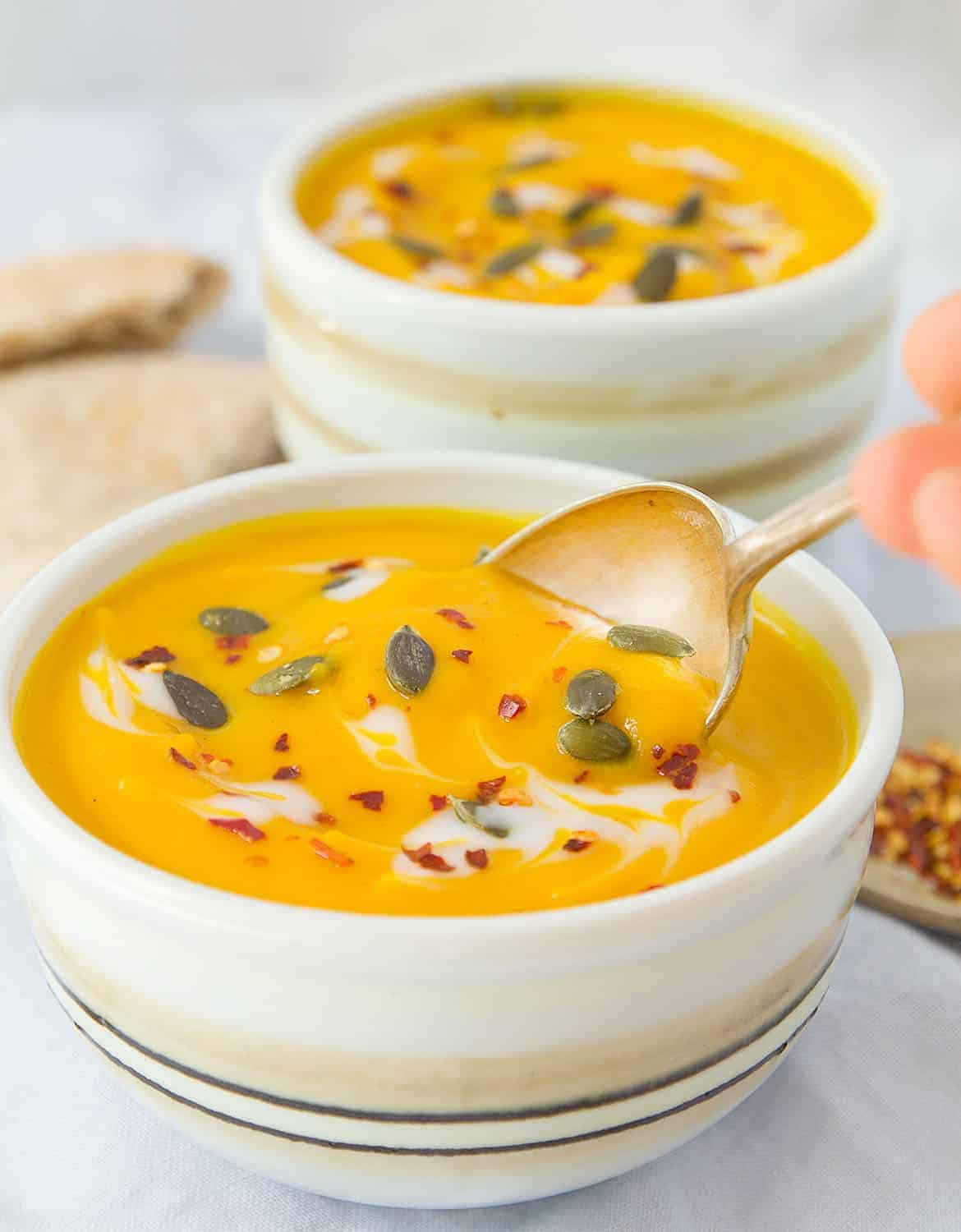 Two bowls full of pumpkin and carrot soup - The Clever Meal
