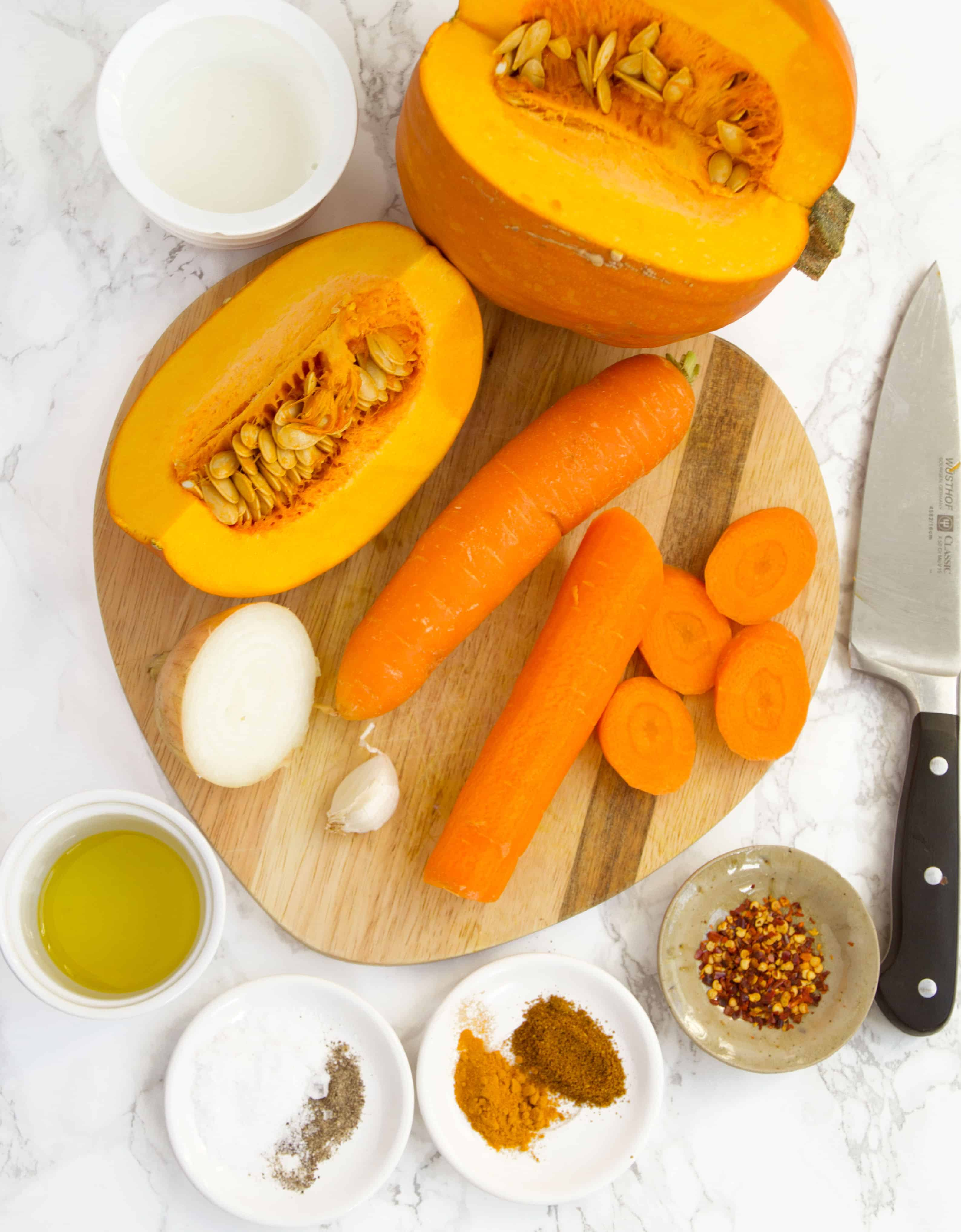 Ingredients to make a delicious pumpkin carrot soup.