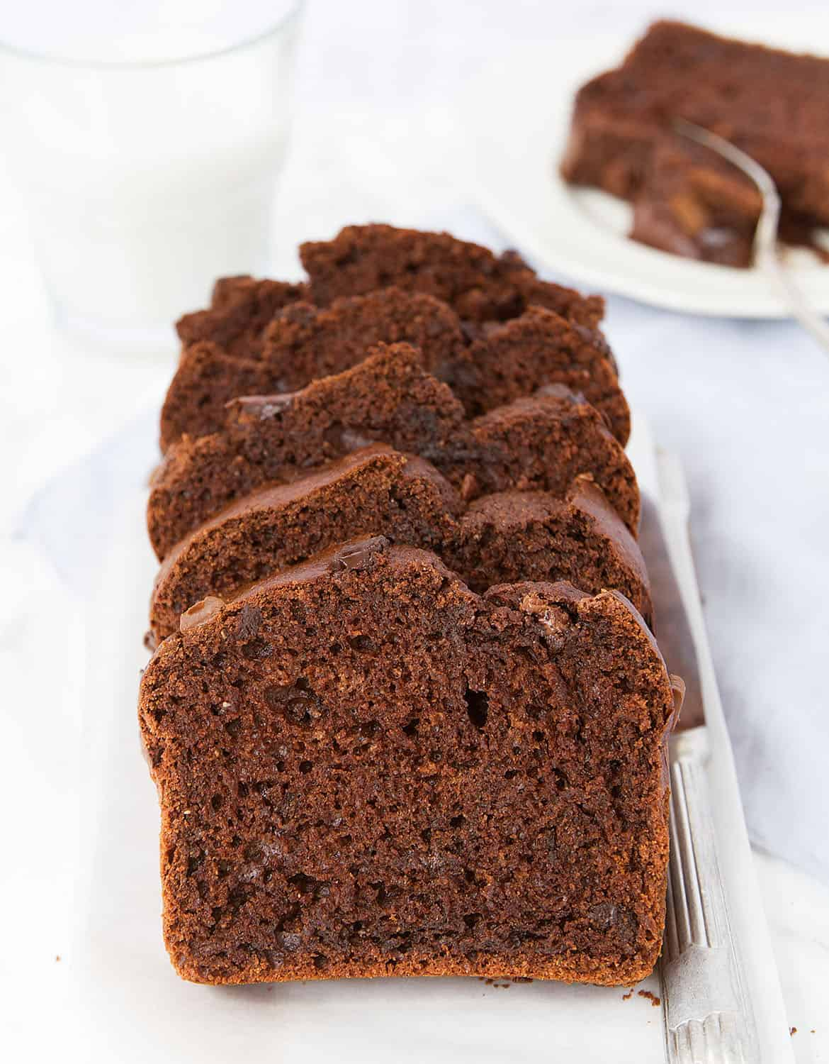 Five slices of healthy chocolate zucchini bread on a white tray - The Clever Meal