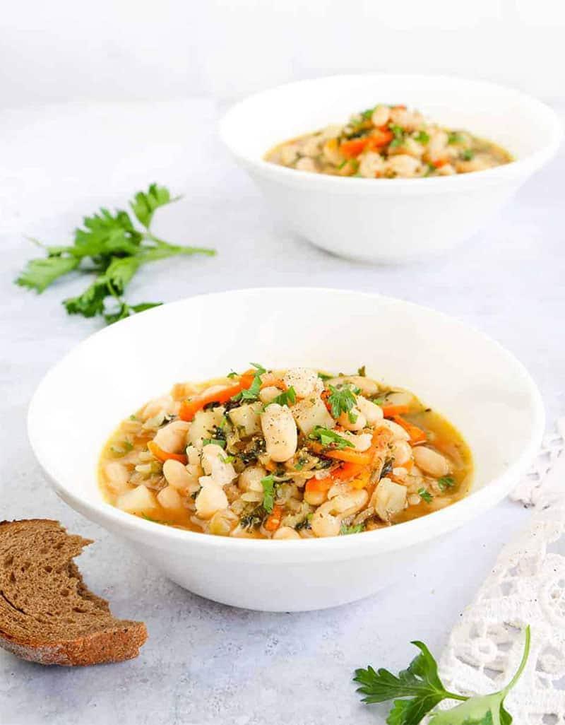 Two white bowls full of white bean soup - Little Sunny Kitchen