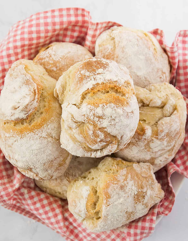 Freshly baked panini bread in a basket.