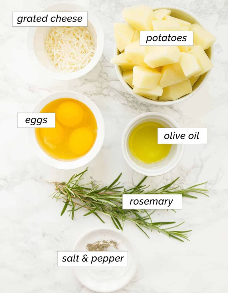 The ingredients to make this potato frittata are arranged over a white background.