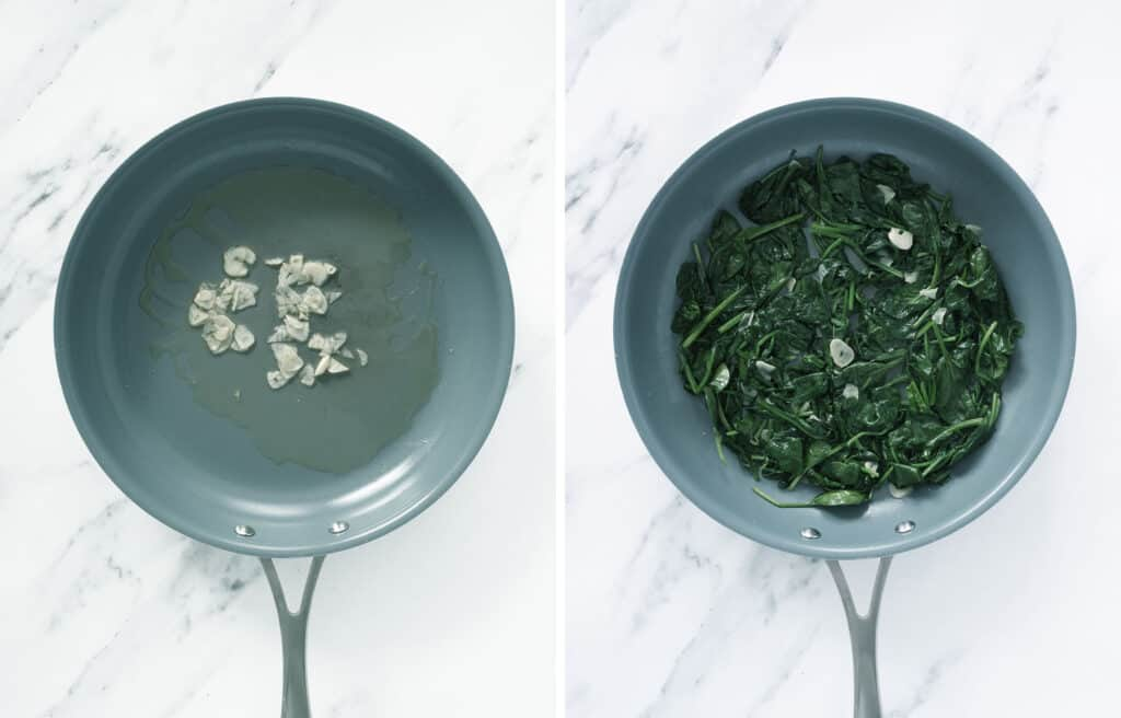 Top view of a skillet with sliced garlic and wilted spinach over a white background.