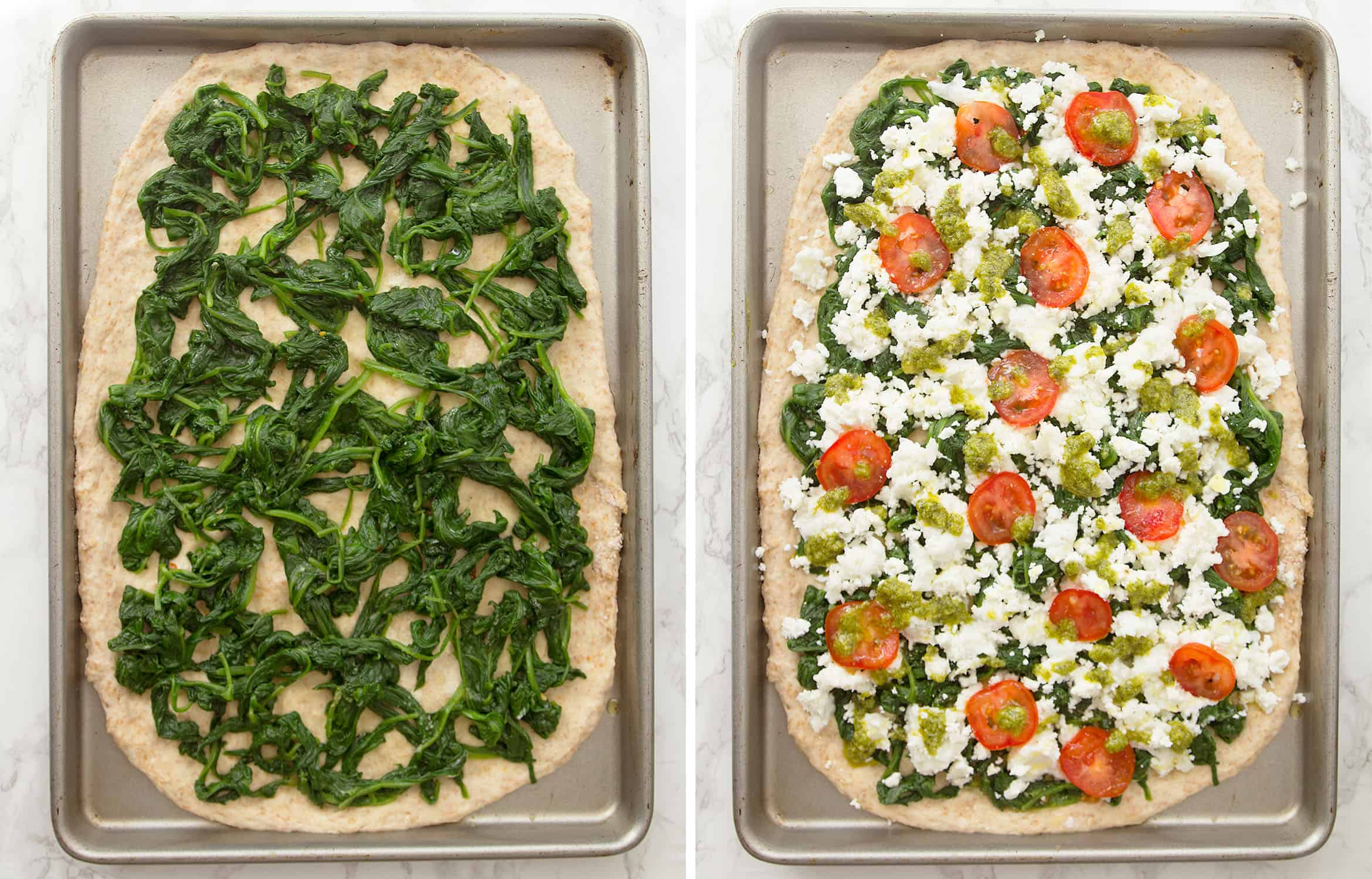 Top view of the spinach pizza with the topping of spinach, feta and tomatoes.