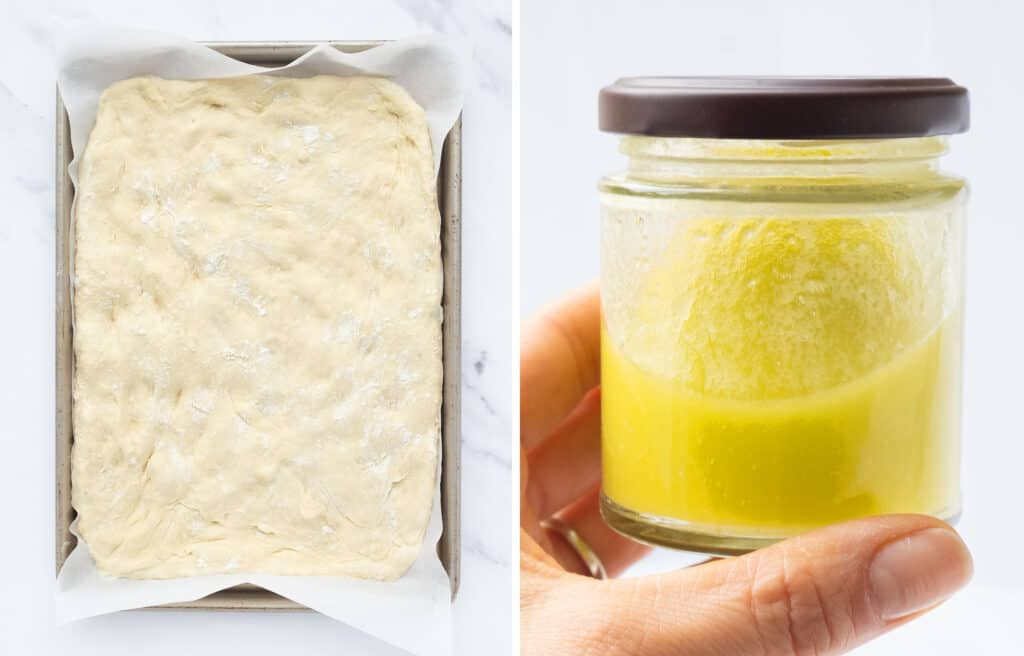 A baking pan with plain focaccia before baking and a jar filledl with olive oil brine.