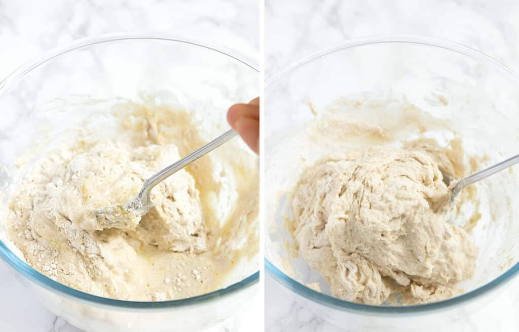 A spoon mixing the focaccia dough in a glass bowl over a white background.