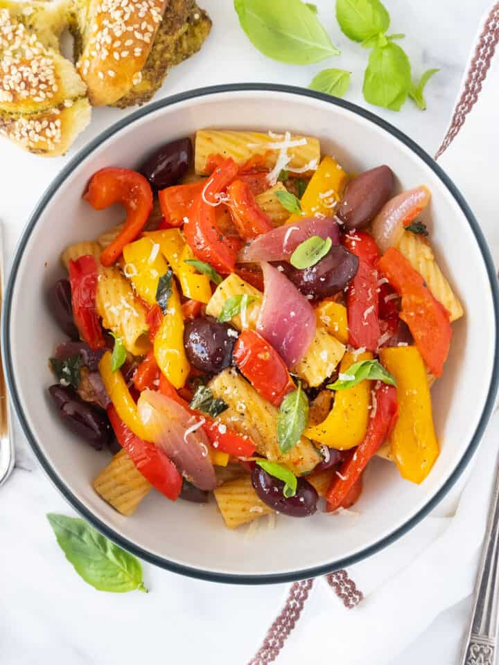Top of a bowl full of pasta with peppers.