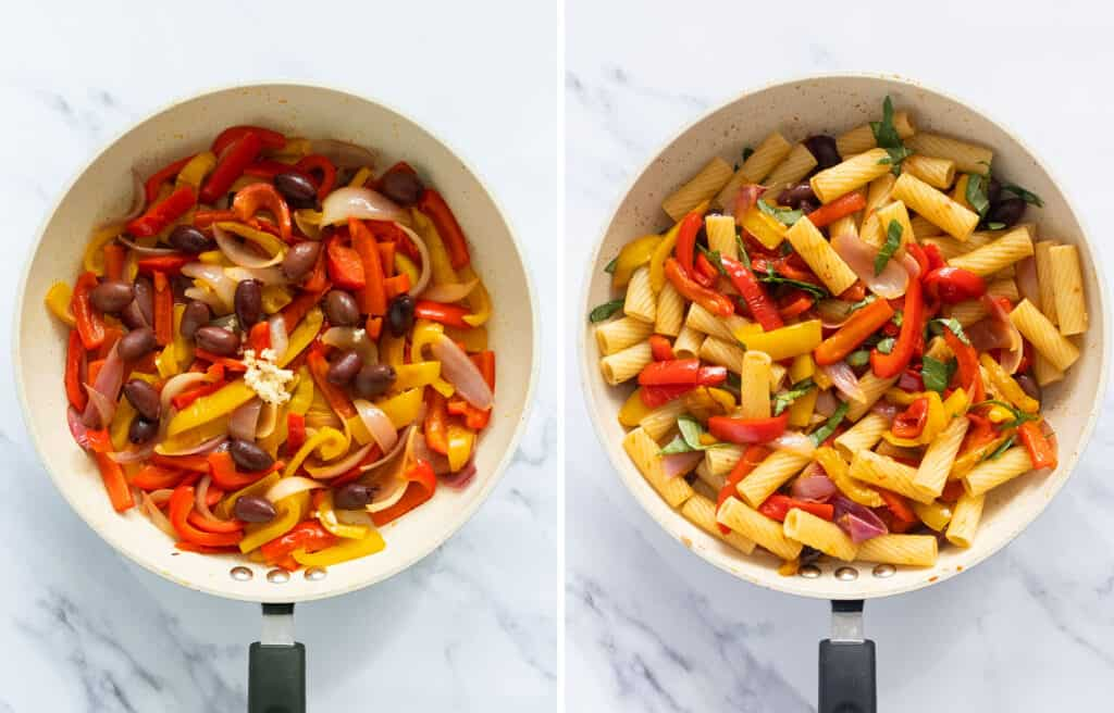 Top view of a pan full of peppers, olives, and rigatoni pasta over a white background.