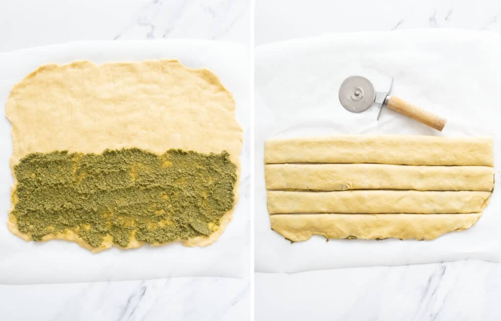 Top view of the pesto bread dough flatten and covered with a layer of pesto, and cut into four slices with a pizza cutter.