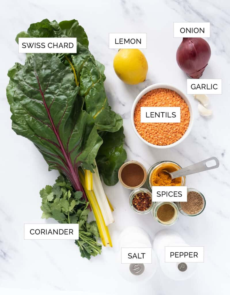 The ingredients to make this Swiss chard soup are arranged over a white background.