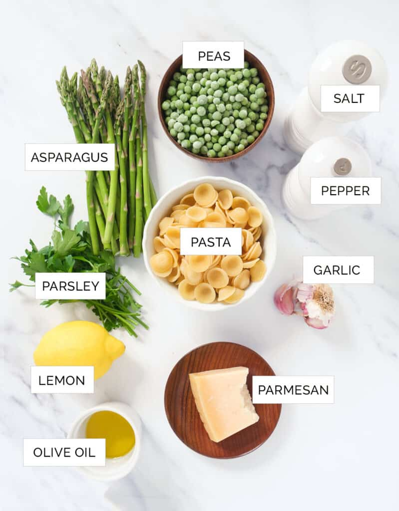 Top view of the ingredients to make the pea and asparagus pasta.