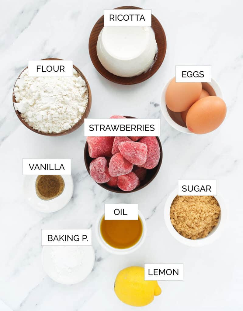 Top view of the ingredients to make this strawberry ricotta cake.