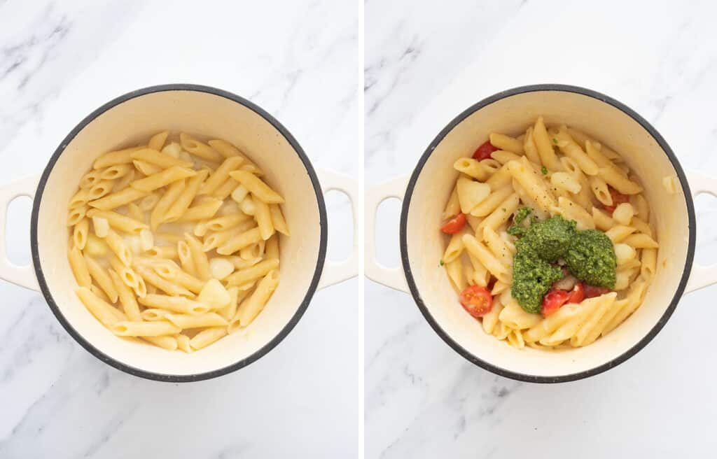 Top view of a white Dutch oven full of penne potatoes, cherry tomatoes and basil pesto.