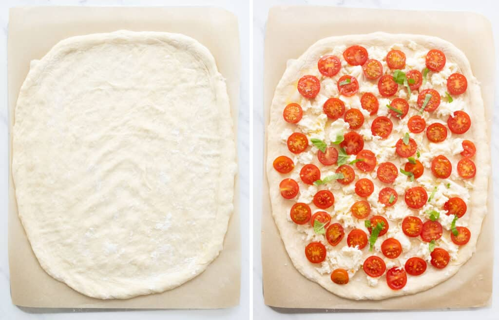 Top view of a parchment paper sheet with pizza dough and fresh tomatoes.