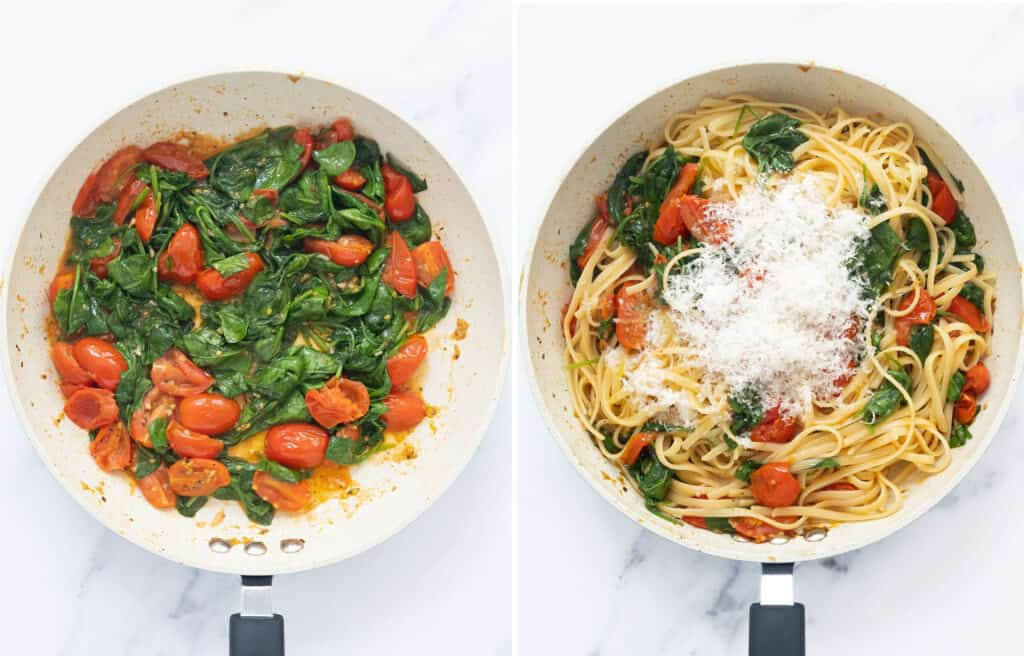 Top view of a white pan full of cherry tomatoes, wilted spinach, pasta and grated parmesan cheese.