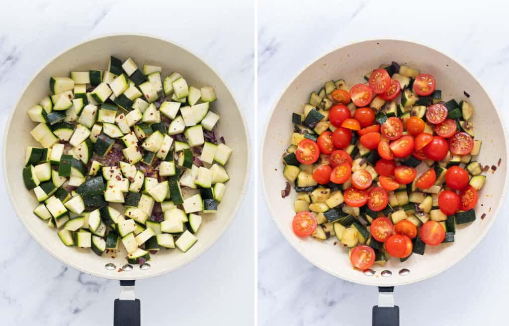 Top view of a white pan with diced zucchini and cherry tomatoes over a white background.