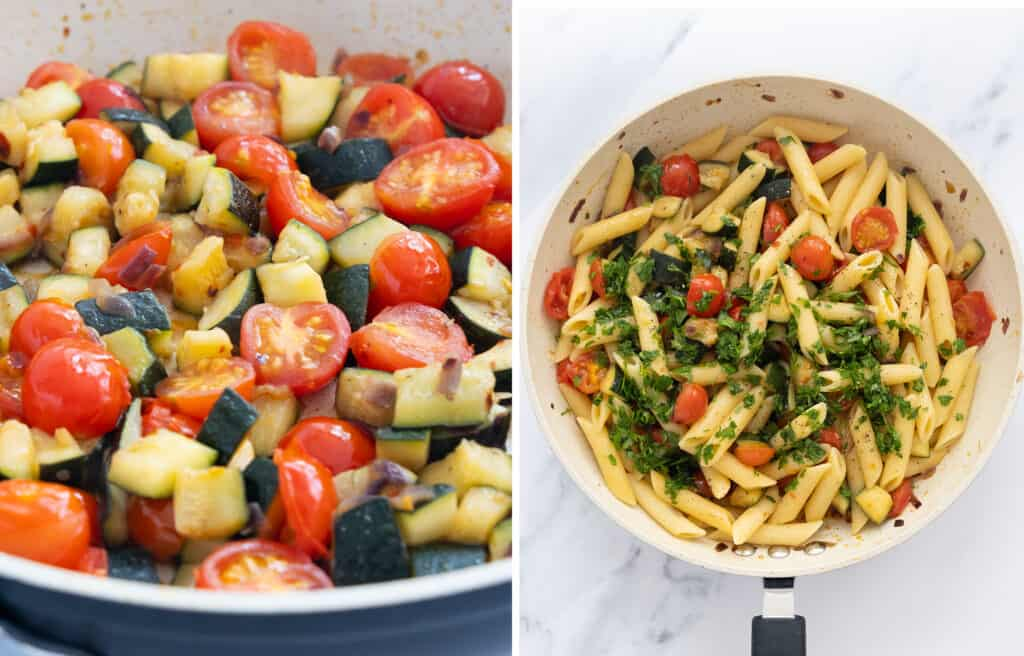Close-up of a pan full of zucchini and tomatoes and penne pasta over a white background.