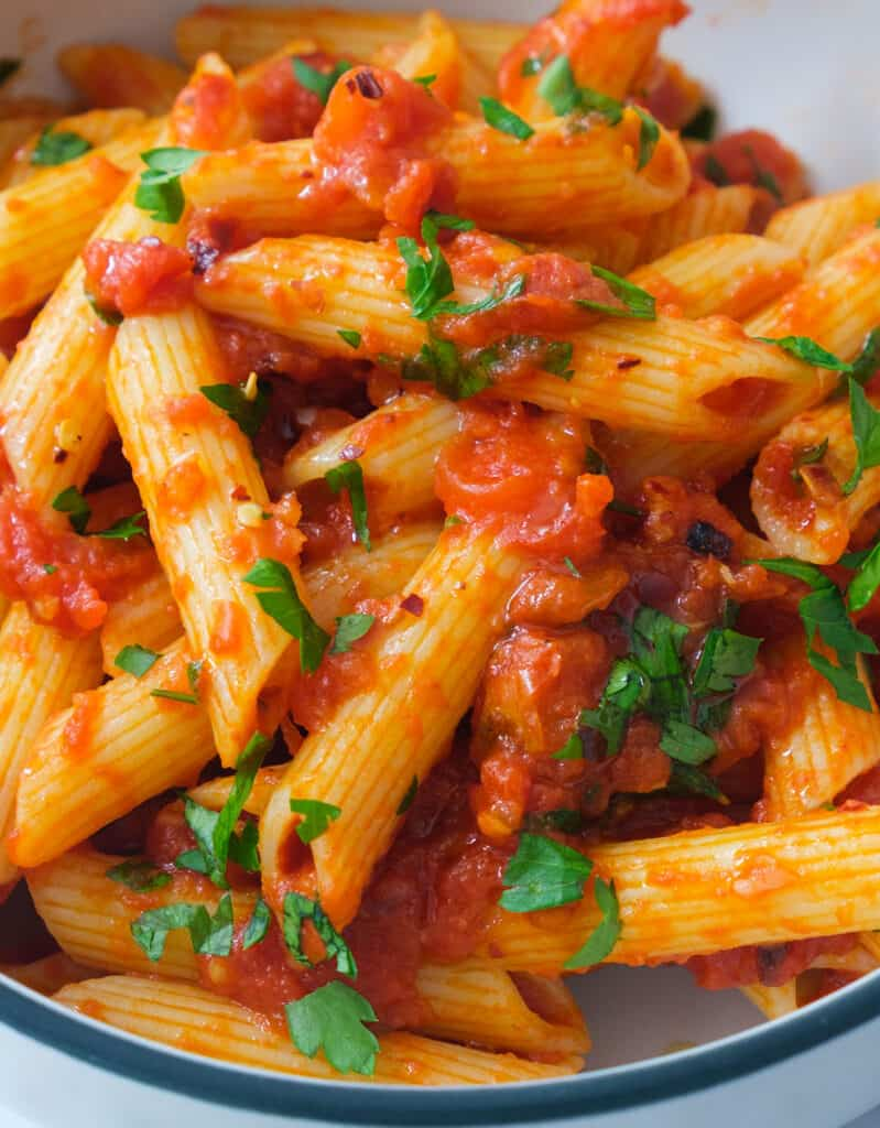 Close-up of some juicy penne with arrabbiata sauce.