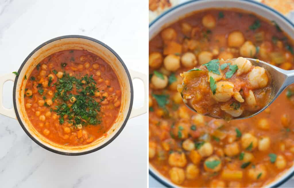 Top view of white Dutch oven and a spoon lifting some rich, thick chickpea stew.