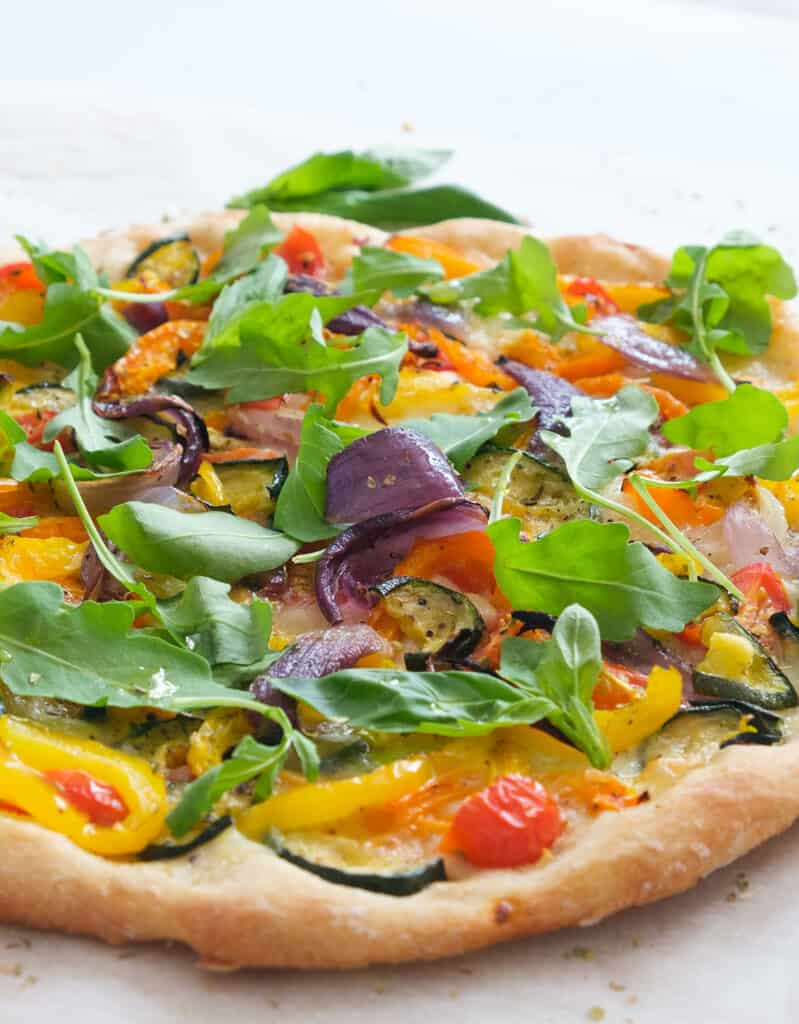 Close-up of a veggie pizza topping and crust.